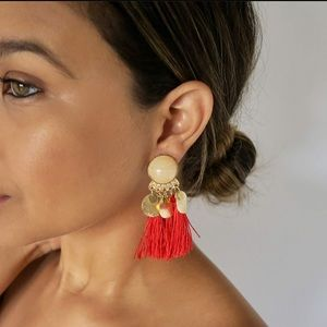 red tassel statement earrings